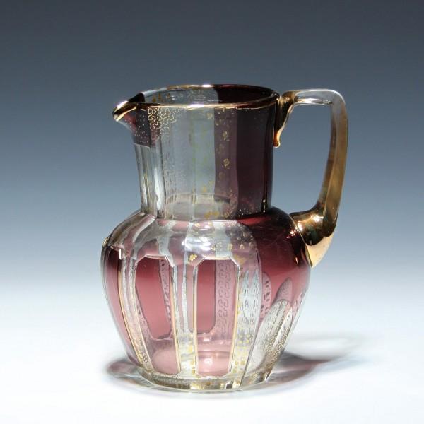 Glaskanne mit Kupferrubinüberfang und Wurmliniendekor - Böhmen circa 1920