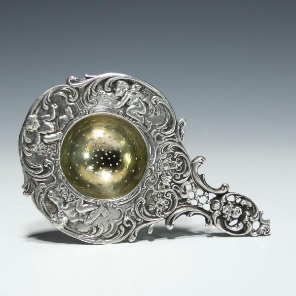 Silbernes Teesieb mit 3 Putten und -Kopf - 800 Silber